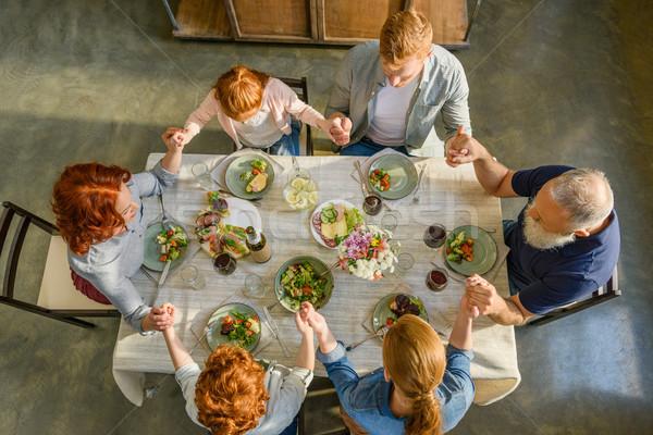 семьи молиться обеда мнение , держась за руки вместе Сток-фото © LightFieldStudios