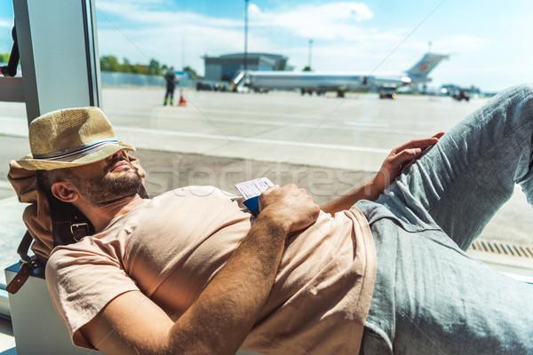 traveler sleeping in airport Stock photo © LightFieldStudios