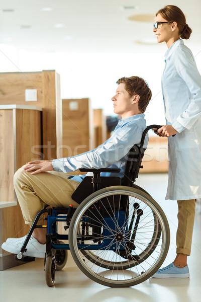 Doktor adam tekerlekli sandalye genç hastane salon Stok fotoğraf © LightFieldStudios