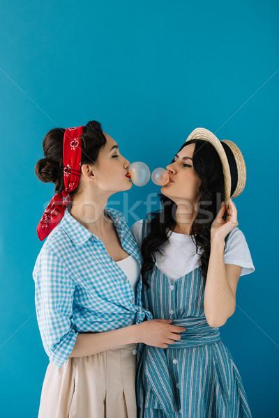 Multikulturális nők fúj buborék íny portré Stock fotó © LightFieldStudios