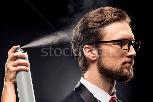 Stylist fixing hairstyle for businessman Stock photo © LightFieldStudios