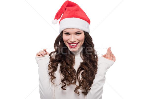 Smiling woman in santa hat Stock photo © LightFieldStudios