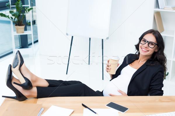 pregnant businesswoman drinking coffee Stock photo © LightFieldStudios