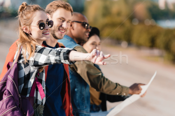 multiethnic friends with map Stock photo © LightFieldStudios