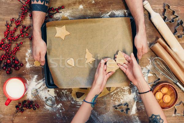 christmas cookies on baking paper Stock photo © LightFieldStudios