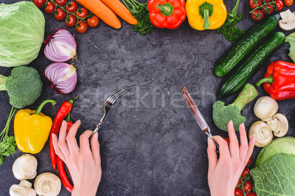Lövés kezek tart villa kés fölött Stock fotó © LightFieldStudios