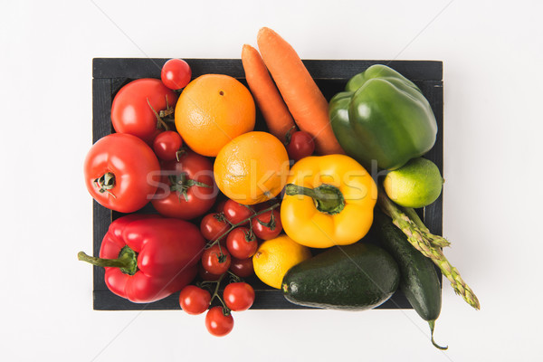 Top view of colorful vegetables and fruits in dark wooden box isolated on white background Stock photo © LightFieldStudios