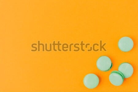 top view of macarons isolated on orange Stock photo © LightFieldStudios