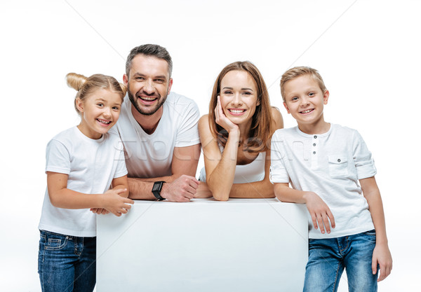 Cheerful family standing together Stock photo © LightFieldStudios