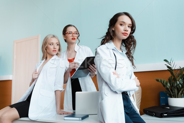low angle view of professional doctors at workplace in cabinet Stock photo © LightFieldStudios