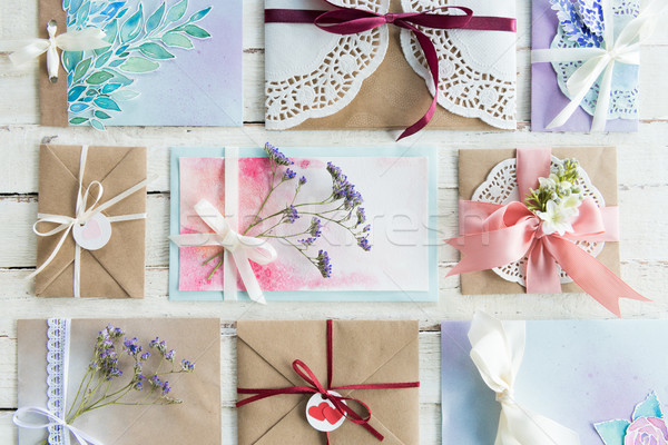 top view of collection of envelopes or invitations on white wooden tabletop, wedding invitation card Stock photo © LightFieldStudios