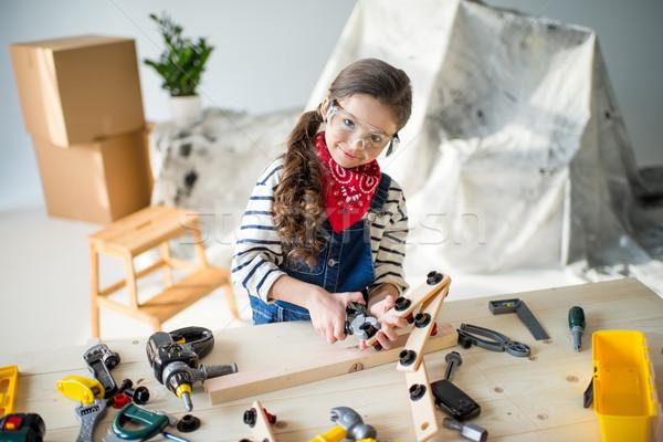 Stockfoto: Meisje · tools · aanbiddelijk · stofbril · spelen · speelgoed
