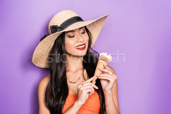 woman in beach attire holding ice-cream Stock photo © LightFieldStudios