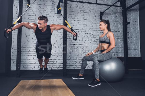 athletic couple in gym Stock photo © LightFieldStudios