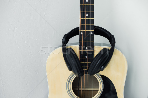 acoustic guitar and headphones Stock photo © LightFieldStudios