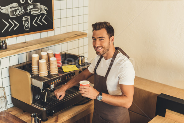 smiling barista with coffee to go Stock photo © LightFieldStudios