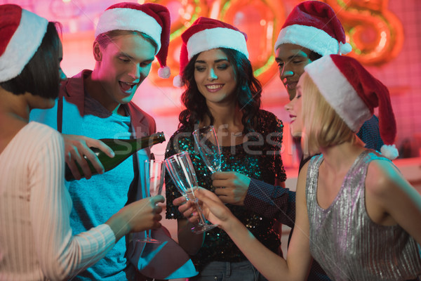 multiethnic friends clinking glasses of champagne Stock photo © LightFieldStudios