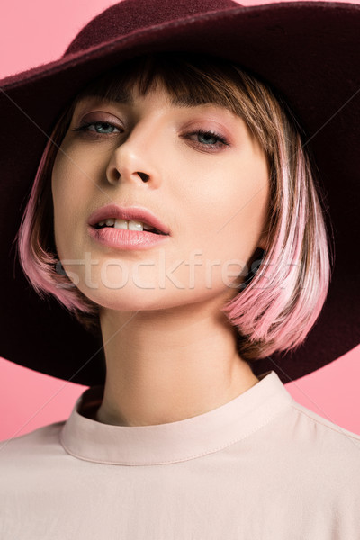 Young woman in wide-brimmed hat Stock photo © LightFieldStudios