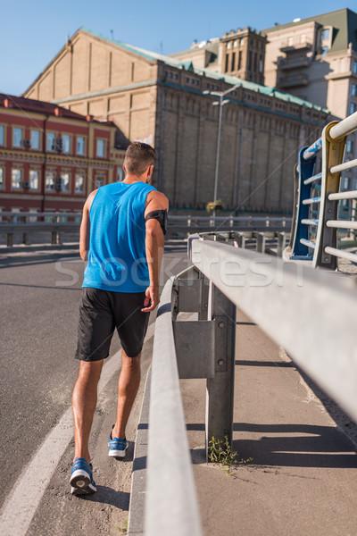 спортсмен работает город вид сзади спортивный спортивная одежда Сток-фото © LightFieldStudios