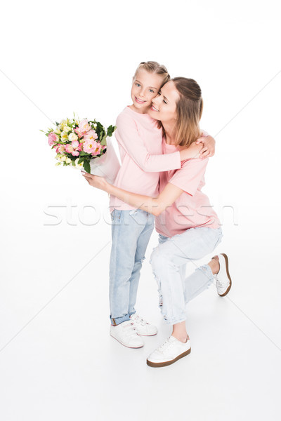 mother and daughter hugging on mothers day Stock photo © LightFieldStudios