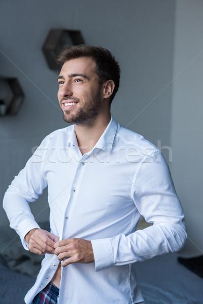 Adam yukarı gömlek atış genç gülen Stok fotoğraf © LightFieldStudios