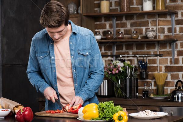Homme cuisson dîner portrait seuls Photo stock © LightFieldStudios