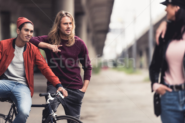 men flirting with woman passing by Stock photo © LightFieldStudios