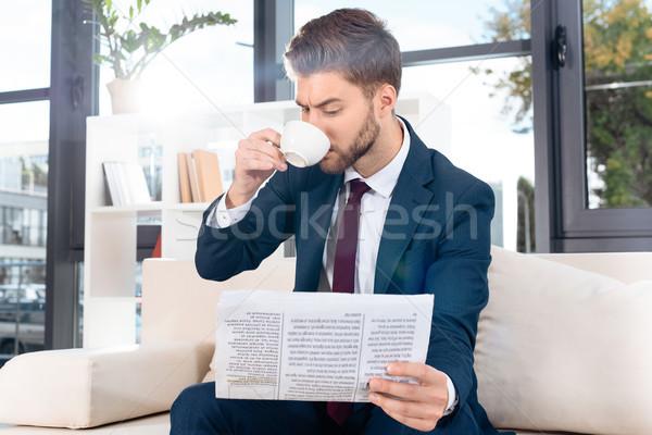 üzletember újság iszik kávé jóképű fiatal Stock fotó © LightFieldStudios
