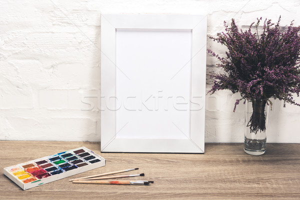 photo frame and drawing equipment on tabletop Stock photo © LightFieldStudios