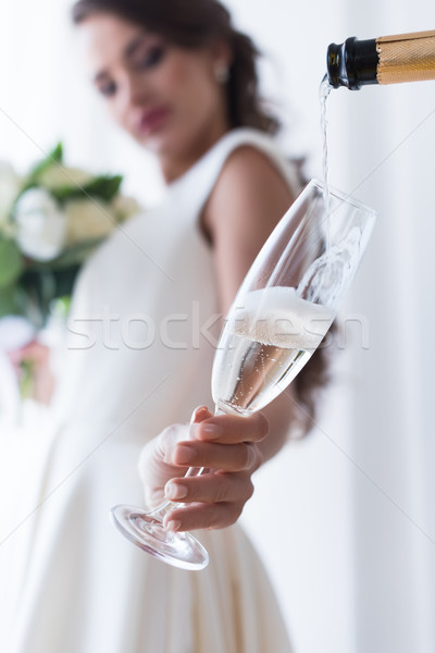 selective focus of bride holding glass of champagne Stock photo © LightFieldStudios
