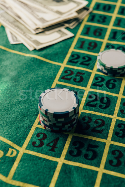 Casino table with placed chips and money banknotes Stock photo © LightFieldStudios