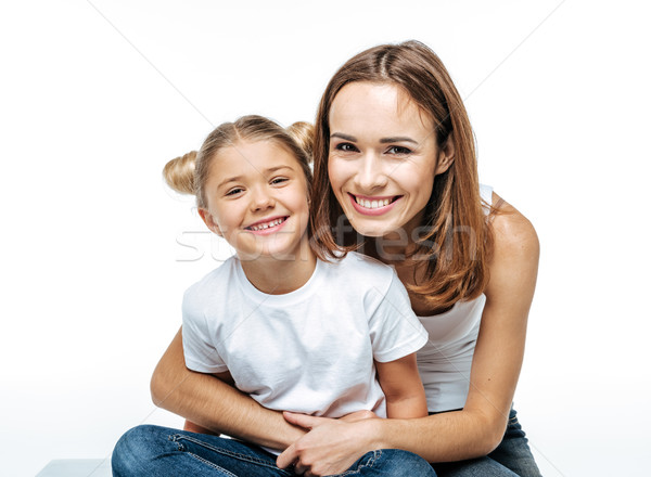 Smiling mother hugging daughter Stock photo © LightFieldStudios