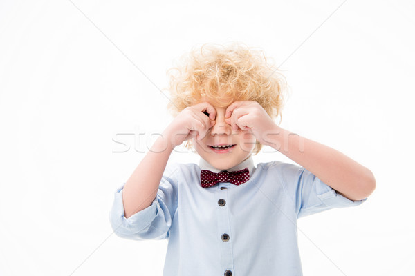 Cute boy gesturing Stock photo © LightFieldStudios
