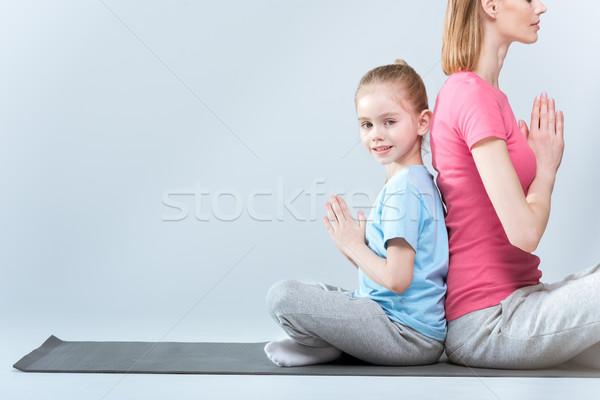 Oldalnézet sportos anya lánygyermek gyakorol lótusz Stock fotó © LightFieldStudios