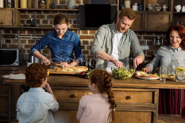 family preparing dinner at home Stock photo © LightFieldStudios