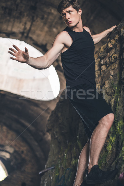 sportive man climbing on ruins Stock photo © LightFieldStudios