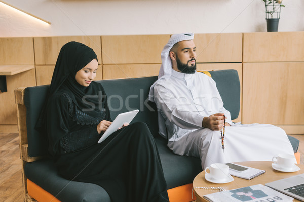 muslim couple sitting on couch Stock photo © LightFieldStudios