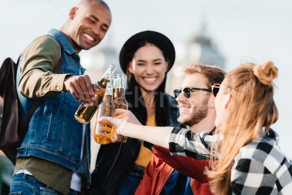 multicultural friends with drinks Stock photo © LightFieldStudios