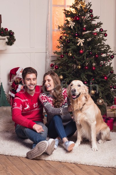couple with dog at christmastime Stock photo © LightFieldStudios