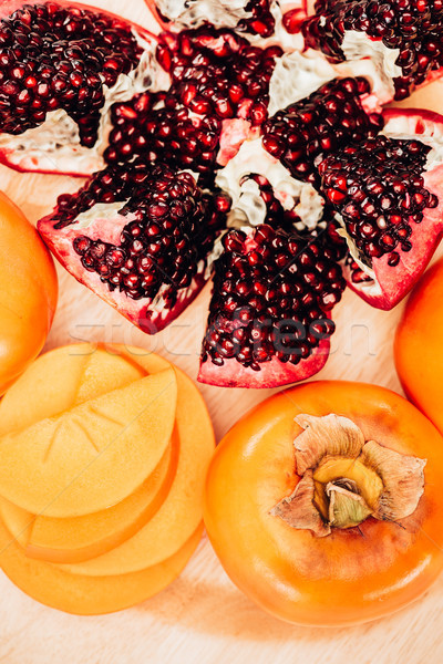 top view of persimmons and pomegranates on plate Stock photo © LightFieldStudios
