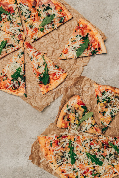 Slices of pizza with arugula on light background Stock photo © LightFieldStudios