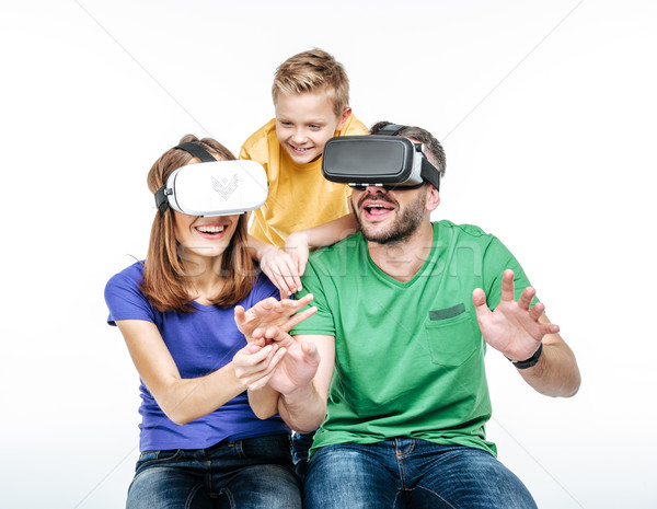 Family using virtual reality headsets Stock photo © LightFieldStudios