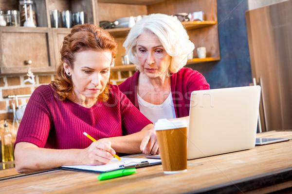 Women usind laptop Stock photo © LightFieldStudios