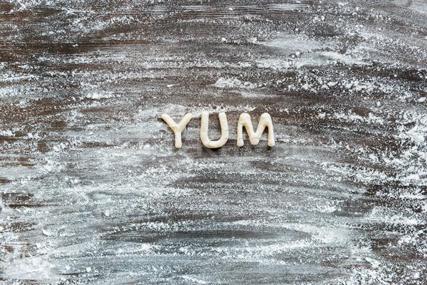 Superior vista palabra yum cookie harina Foto stock © LightFieldStudios