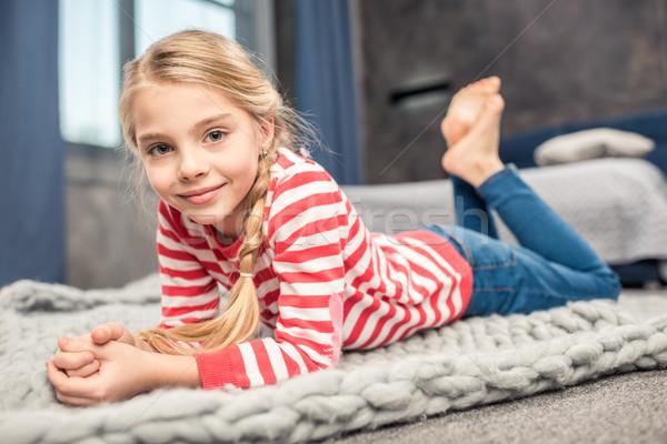 Smiling little girl Stock photo © LightFieldStudios