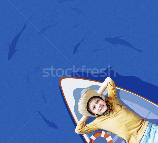 boy on floating boat  Stock photo © LightFieldStudios