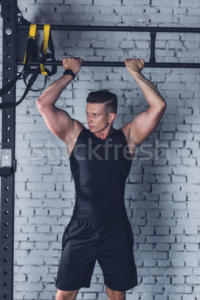 спортивный человека спортзал рук вверх Сток-фото © LightFieldStudios