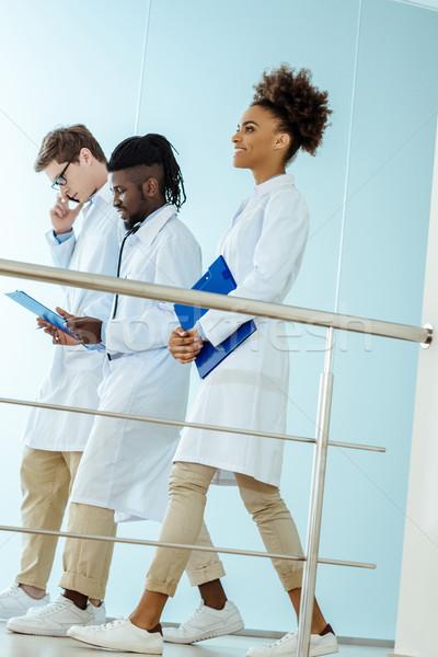 medical interns walking in hospital Stock photo © LightFieldStudios