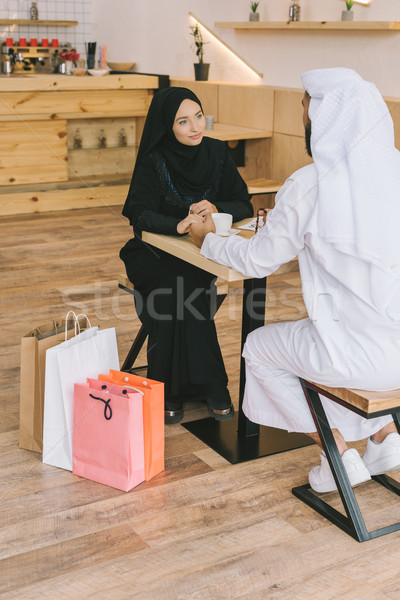 Musulmans couple séance café jeunes Shopping Photo stock © LightFieldStudios