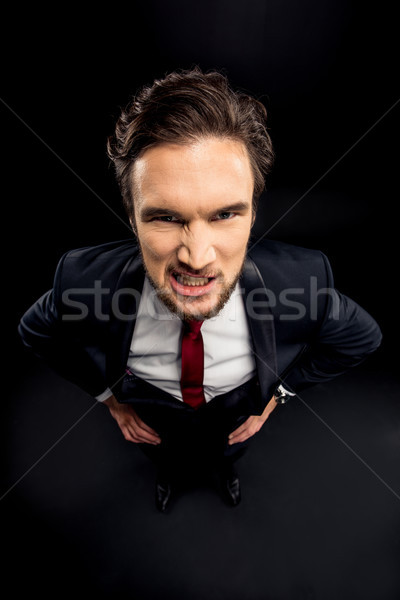Annoyed businessman in formalwear  Stock photo © LightFieldStudios